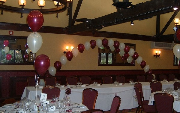 beautiful burgundy & ivory top table arch as part of wedding balloon packages