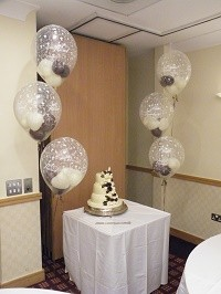 Large diamond clear balloons containing floating hearts