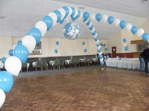 criss- cross arch, exploding balloon and 10 (3) balloon table bouquets