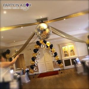 exploding balloon tulle ceiling arrangement